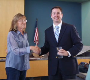 RWCC President Anne Stiles greets Mark Nichols at the Saturday morning meeting